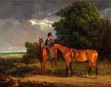 groom mounted on a chestnut hunter he holds a bay hunter