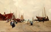 fishermen and trawlers on the beach