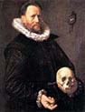 A Man Holding a Skull